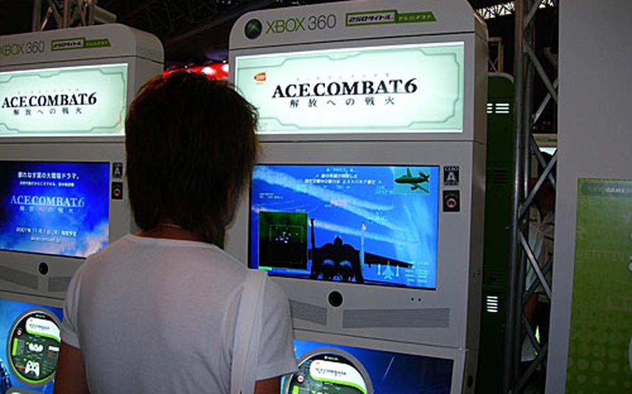 """A visitor to the 2007 Tokyo Game Show plays """"Ace Combat 6."""""""