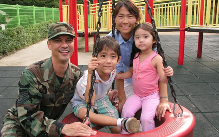 Air Force Tech. Sgt. Mike Tateishi and wife Mi-hwa with their children Ian, 5, and Erica, 3, at Osan Air Base, South Korea.