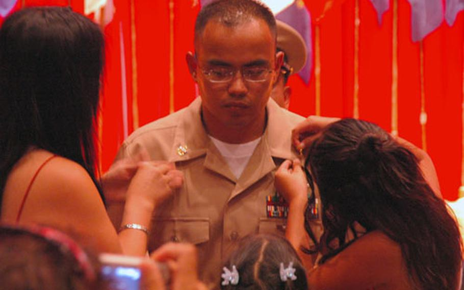 After a six-week induction process, chief petty officer selects were presented their anchors, the symbol of the rank and title of a U.S. Navy chief petty officer.