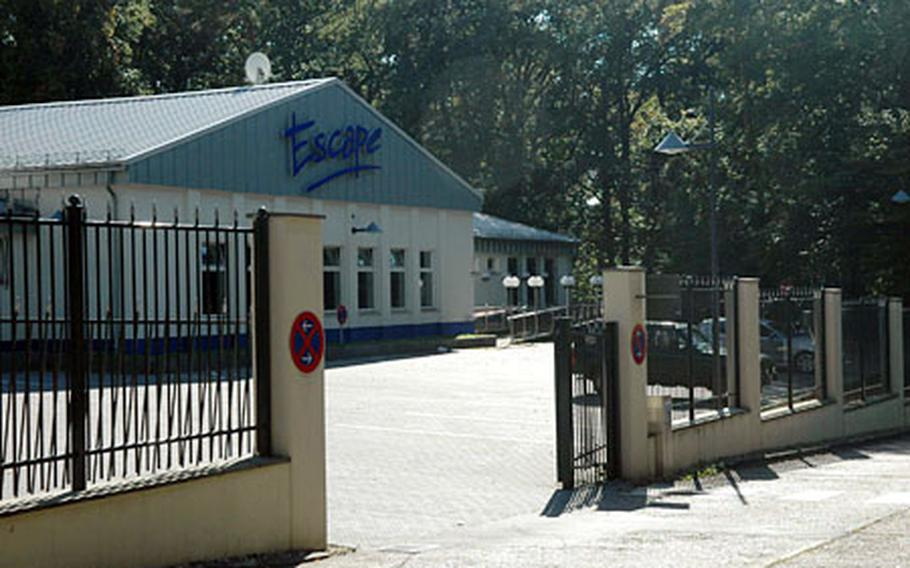 The Escape Club, just outside the gates at Cambrai Fritsch Casern, has been closed since May, though cars still park in its lot. It was among the first places to close in the community.
