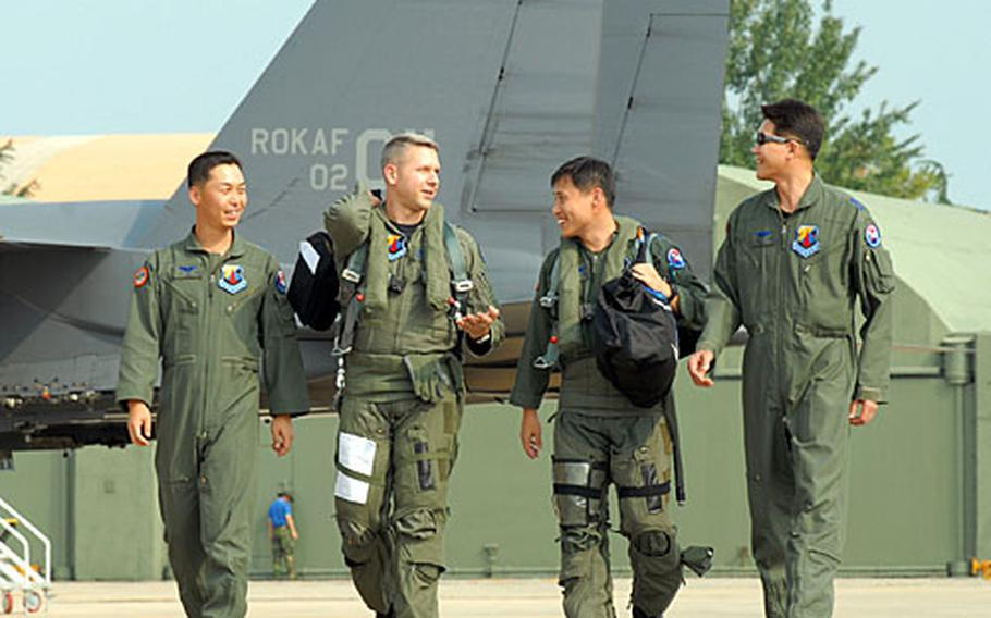 Maj. Craig Vincent walks with a group of South Korean pilots he trained in South Korea. Vincent spent nine months here instructing the South Korean Air Force on their recently acquired F-15K.