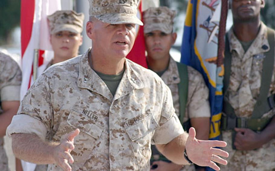 Maj. Gen. Robert B. Neller, 3rd Marine Division commander, talks to Marines at the division's 65th anniversary ceremony Monday on Camp Courtney, Okinawa. Neller took command of the division in June.