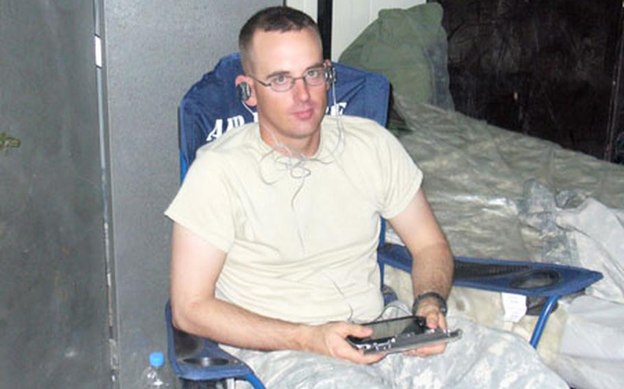 Sgt. Joel Murray relaxes at FOB Rustamiyah in east Baghdad.