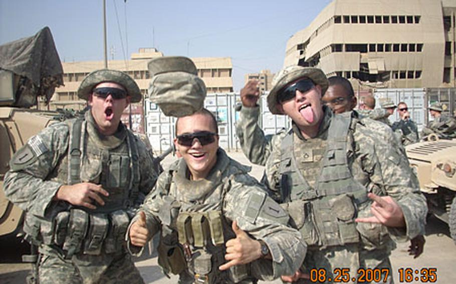 Pfc. Joseph Mixson, Spc. David Lane and Pfc. Kurtiss Baumgartner have a laugh before going on patrol in east Baghdad.