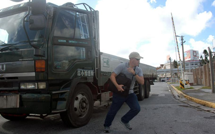 Acting as a terrorist, Staff Sgt. Doug Howell sprints from a truck to plant a simulated bomb.