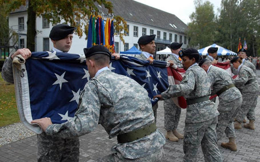 Soldiers from U.S. Army Garrison Hessen fold the flag for the last time in Giessen, Germany, at the closure ceremony for the garrison.