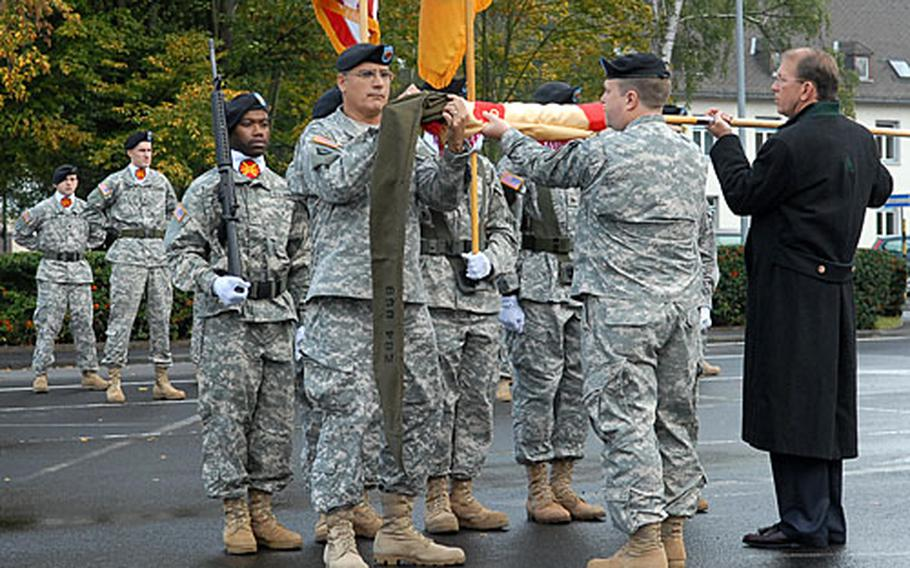 Col. Ray Graham Jr., commander of U.S. Army Garrison Wiesbaden, center, and USAG Hessen Command Sgt. Maj. Jose Fontanez,left, sheath the colors of USAG Giessen, held by Craig Brichard, the garrison manager.