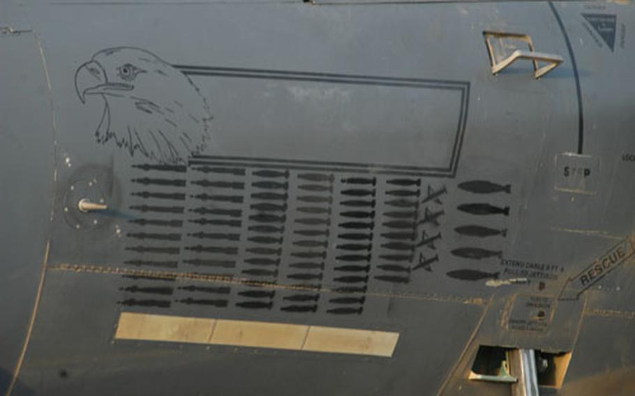 A collection of painted bombs adorn the side of a F-15E assigned to RAF Lakenheath-based 492nd Fighter Squadron. The paintings represent the number of bombs each jet has launched while deployed to Afghanistan.