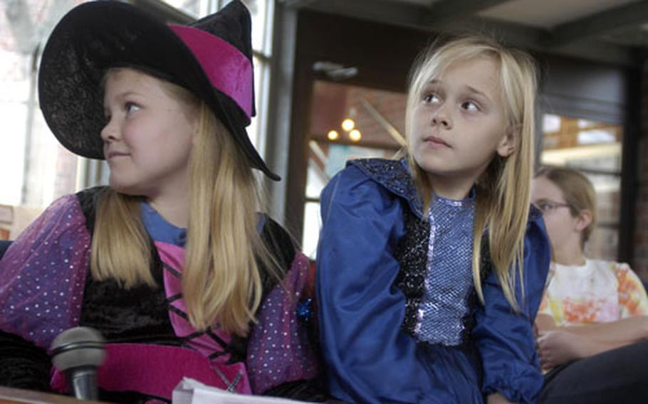 Third-graders Sarah Tingley, left, and Faith Slocum served as emcees during the Halloween Readers Theater Fest.