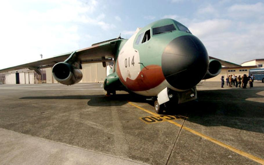 A Japanese C-1 from Miho Air Base makes a final stop at Yokota Air Base on Wednesday. The Japan Air Self-Defense Force is halting Operation Freedom Lift, a six-year airlift mission put in place to help free up U.S. aircraft for the war on terror and other operations.