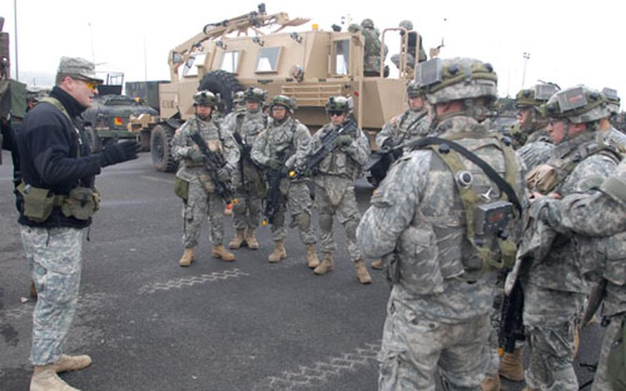Members of Company B, 40th Engineer Battalion prepare for a route-clearance mission using a simulated Buffalo armored vehicle, rear, at Hohenfels. Soldiers from Company B, 40th Engineer Battalion, are in Hohenfels training for an upcoming deployment to Iraq.