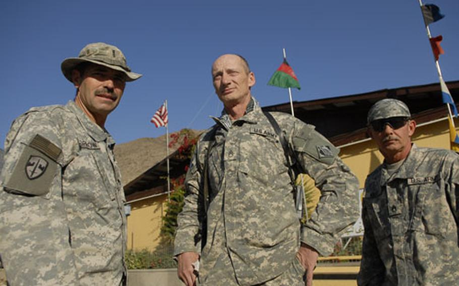 From left, Chief Warrant Officer 4 Steven Morrow, 58, of Camp Verde, Ariz.; Staff Sgt. Steven Cardoza, 52, of Rathdrum, Idaho; and Staff Sgt. Coyde Wolfe, 48, from Covington, Virginia, pose for a photo at Camp Wright in northeastern Afghanistan. The men are all attached to the Army Corps of Engineers and between them have decades of off and on service in the Army. But Morrow beats them all with nearly 40 years of consecutive service between the U.S. Marine Corps and Army.