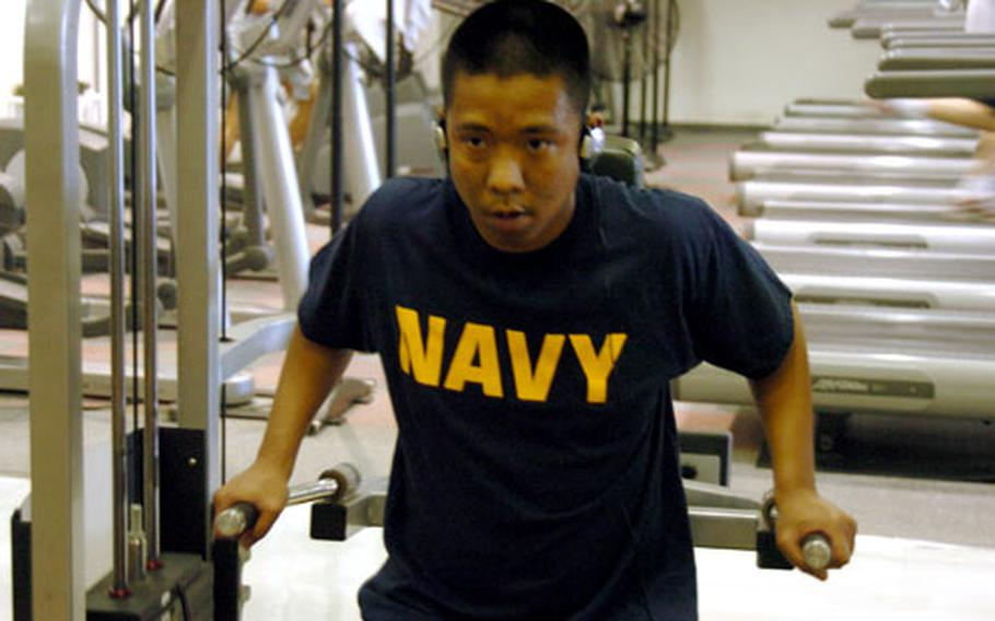 Petty Officer 2nd Class Raymond Leynes lift weights at Naval Air Facility Atsugi's gym. Sailors have incentive to get in shape as three fitness failures in four years can trigger an automatic separation.