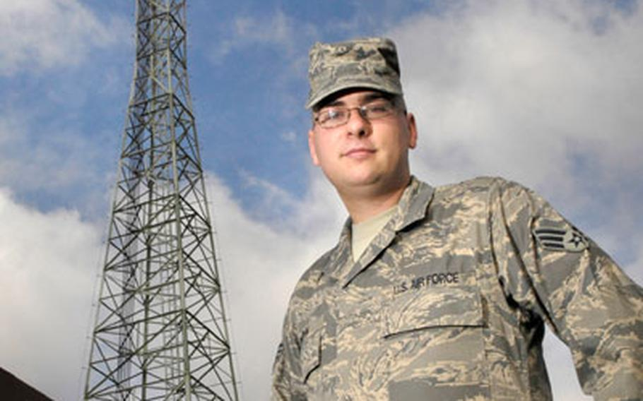 Senior Airman Quentin Bruhn, who is assigned to the 435th Communications Squadron, shows off the new uniform outside Ramstein Air Base's Ground Control Approach facility, where he maintains communications equipment.