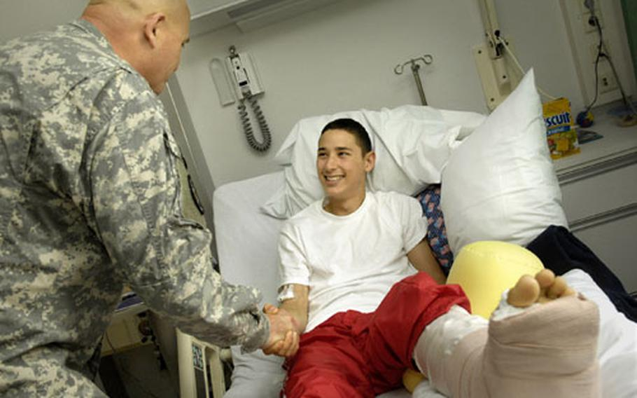 Lt. Gen. Kenneth Hunzeker visits Army Spc. Sean Staggs, 21, from the 2nd Stryker Cavalry Regiment out of Vilseck, Germany. Staggs was wounded near Bahgdad when his vehicle was hit by a roadside bomb.