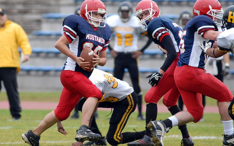 Menwith Hill's Edward Barrera rushes in the Division IV title game against Hanau. The Mustangs lost the game 58-20.