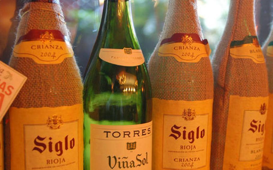 Bottles of wine line the mantle at La Tasca restaurant.