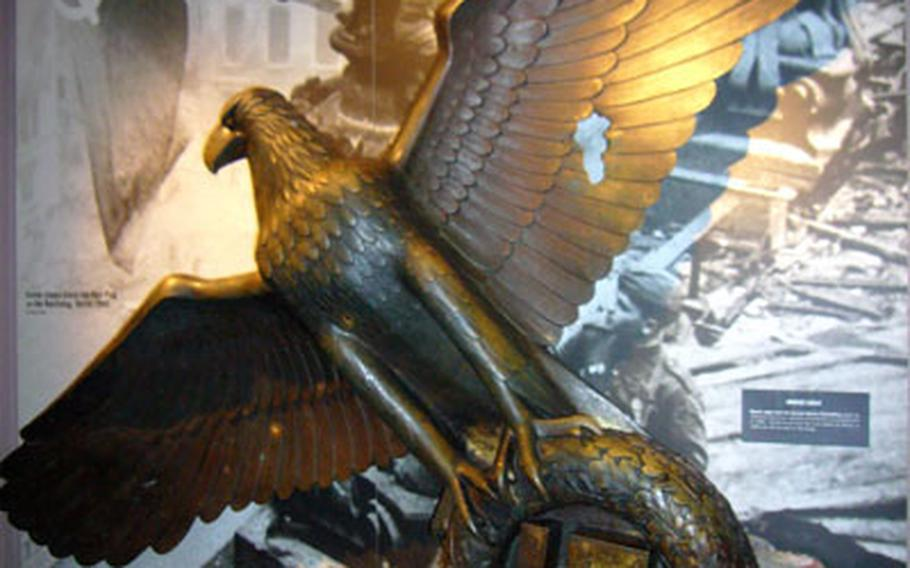 A bronze Nazi eagle, damaged from battle, is displayed inside London's Imperial War Museum. The six-floor museum has numerous exhibits with aircraft, vehicles, uniforms and other military-related items.