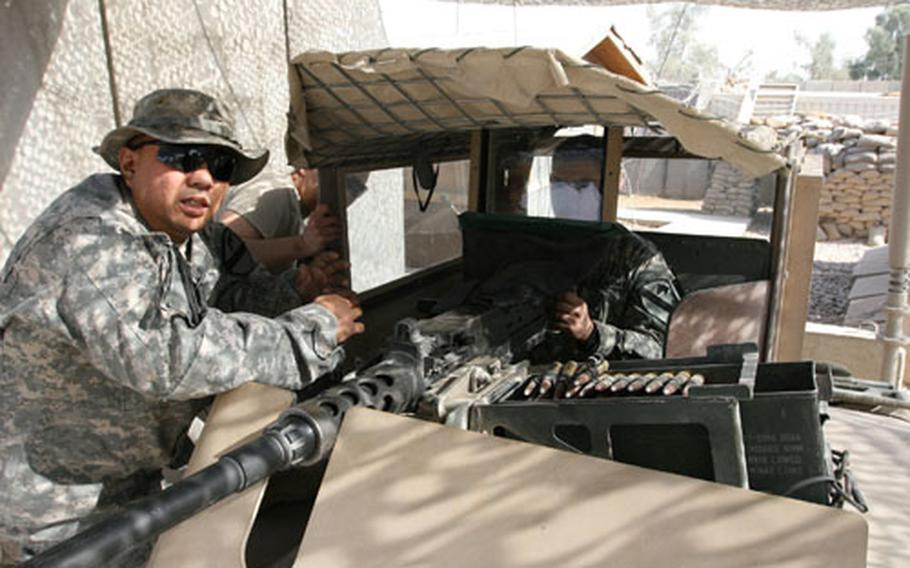 Sgt. Mabon Briola (left), 36, of Yigo, Guam, a soldier with Apache Company, 2nd Battalion, 7th Cavalry Regiment, from Fort Bliss, Texas, created a bulletproof face shield to protect Humvee turret gunners. Spc. Gabriel Hernandez, 22, of San Antonio, Texas, mans a .50-caliber machine gun behind the bullet-proof glass shield.