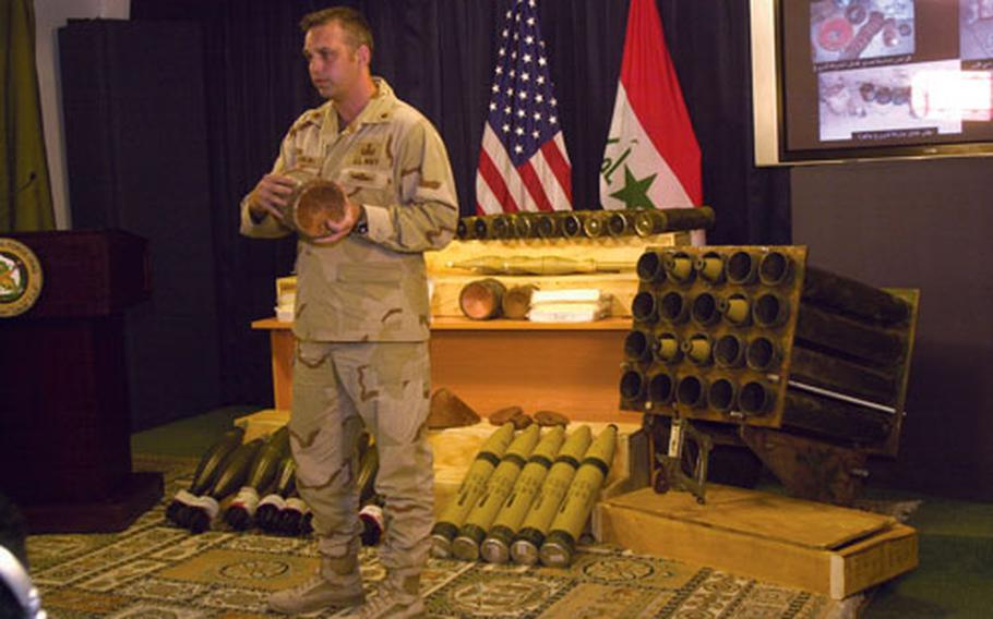 Navy Lt. Cmdr. Keith Dowling explains how an explosively formed penetrator (EFP) works at a Baghdad press conference. Officials say weapons cache finds have doubled since Oct. 2006 and roadside bomb attacks fell to 2004-levels last month.