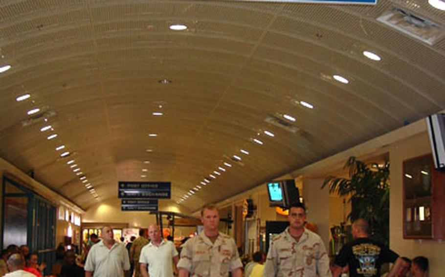 Sailors and those who work at Naval Support Activity Bahrain walk in the Freedom Souq. The U.S. Navy base in Bahrain has doubled the number of sailors over the years and millions have been spent to improve the base.