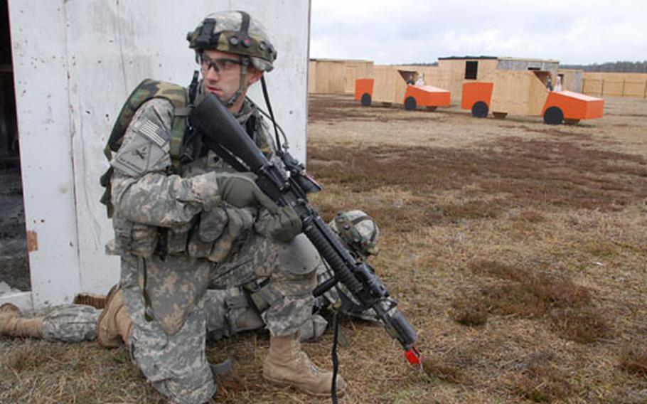 A 1st Battalion, 6th Infantry Regiment soldier at a military operations in urban terrain (MOUT) site at Grafenwöhr Training Area.