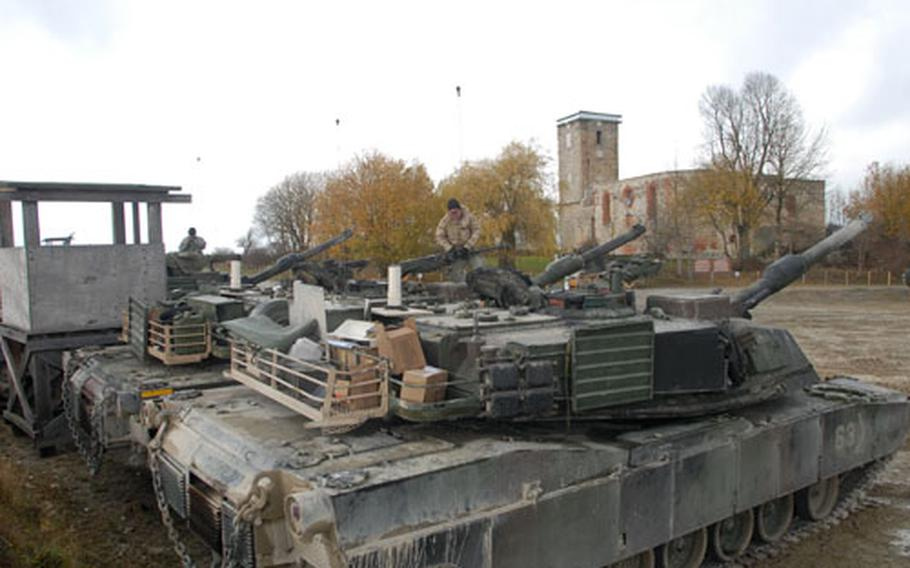 1st Battalion, 6th Infantry Regiment soldiers are living in temporary combat outposts at Grafenwohr Training Area during a mission rehearsal exercise to prepare them for deployment to Iraq early next year. This combat outpost is next to the 700-year-old Hopfenohe church.