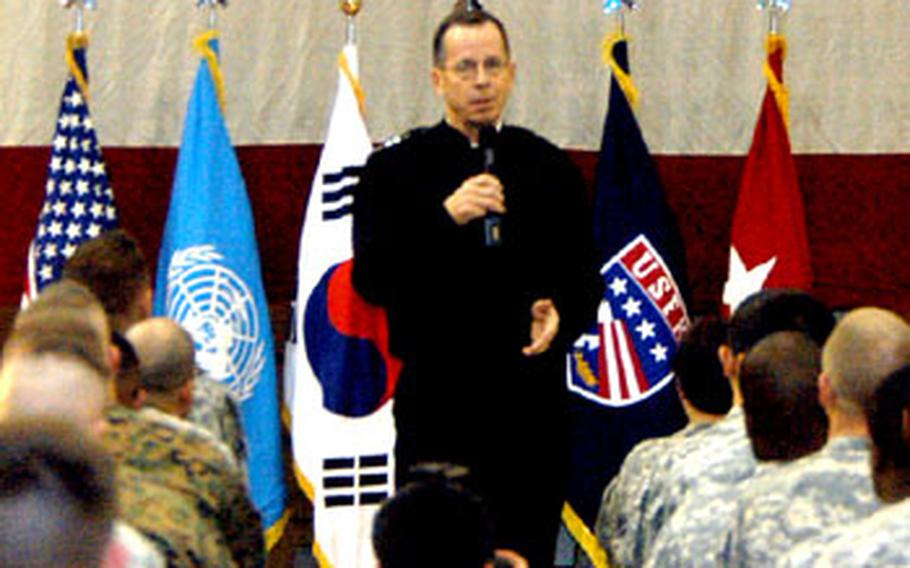 Chairman of the Joint Chiefs of Staff Adm. Mike Mullen addresses a crowd of servicemembers Wednesday in Collier Field House at Yongsan Garrison, South Korea.
