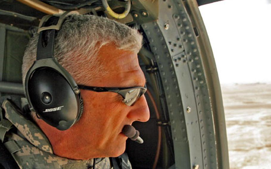 Maj. Gen. Mark Hertling looks out at the northern Iraqi desert during a flight Tuesday from Contigency Operating Base Speicher to a U.S. outpost near Samarra. Hertling, the commander of the 1st Armored Division, took command last month of U.S. forces in northern Iraq.