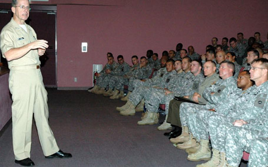 Adm. Mike Mullen, chairman of the Joint Chiefs of Staff, talks Thursday to soldiers at Camp Zama in Japan about downrange deployments, military contractors and medical care for wounded servicemembers.