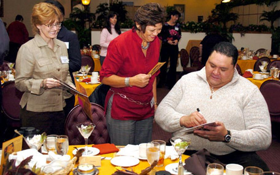Chad Rowan, better known as Akebono, signs autographs for members of the Yokota Officers Spouses Club.
