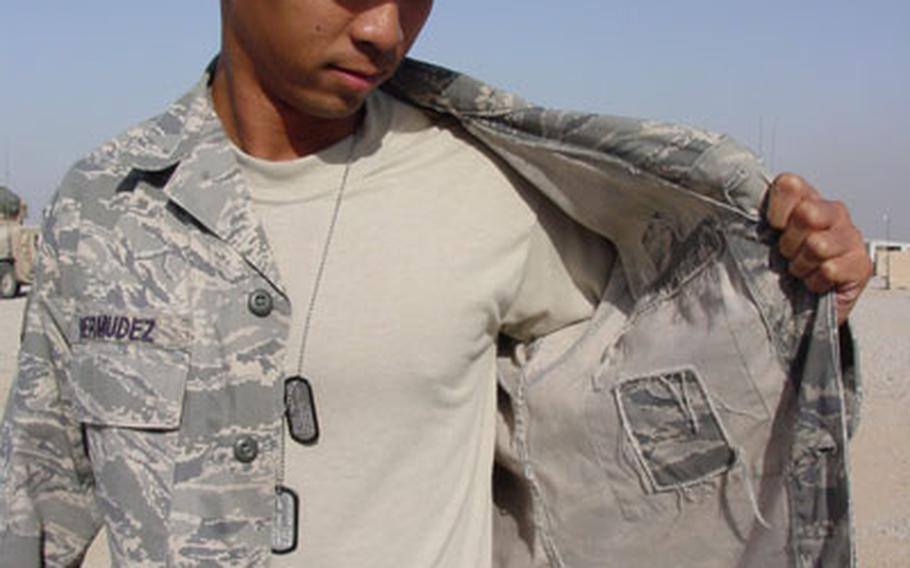 Senior Airman Michael Bermudez, assigned to the 732nd Expeditionary Security Forces Squadron in Iraq, on Sunday shows the inside of his uniform with the map pocket removed.