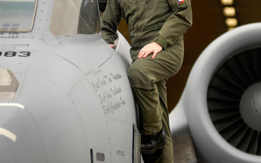 """Capt. Scott Markle, a fighter pilot assigned to the 81st Fighter Squadron, poses by an A-10 at Spangdahlem Air Base, Germany. Last month, Markle was awarded the Mackay Trophy for the """"most meritorious flight of the year"""" when he engaged a group of Taliban fighters battling a Special Forces team on the Afghanistan-Pakistan border."""