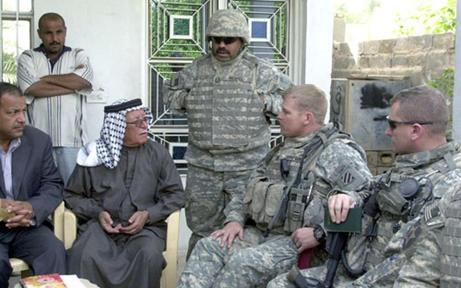 Sheik Nori Zbar Al-Jaboori talks with Company B commander Capt. Richard Thompson, second from right, and Lt Col. Jack Marr, commander of the 3rd Infantry Division's 1st Battalion, 15th Infantry Regiment Thursday in Al-Jara.