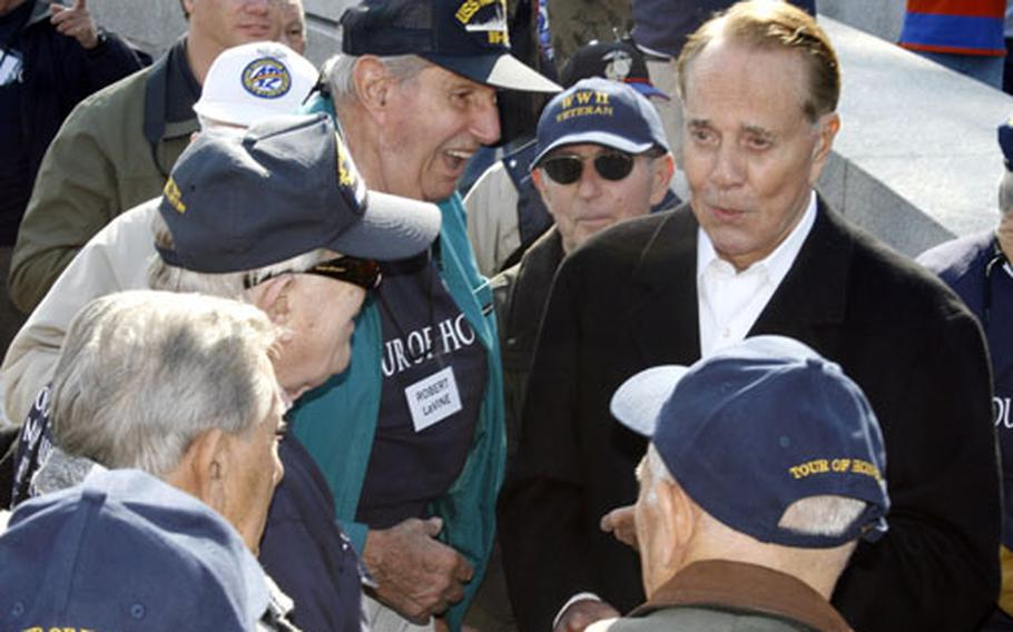 Veterans from Somerset County, N.J., talk with former Sen. Bob Dole at the National World War II Memorial on Sunday.