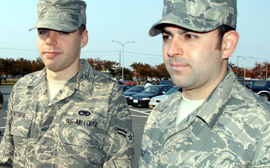 Airman 1st Class Kyle Partridge, left, and Senior Airman James Decker, of the 373rd Support Squadron at Misawa Air Base, Japan, wear the new Airman Battle Uniform, or ABU. They ordered the uniforms online about a month ago.