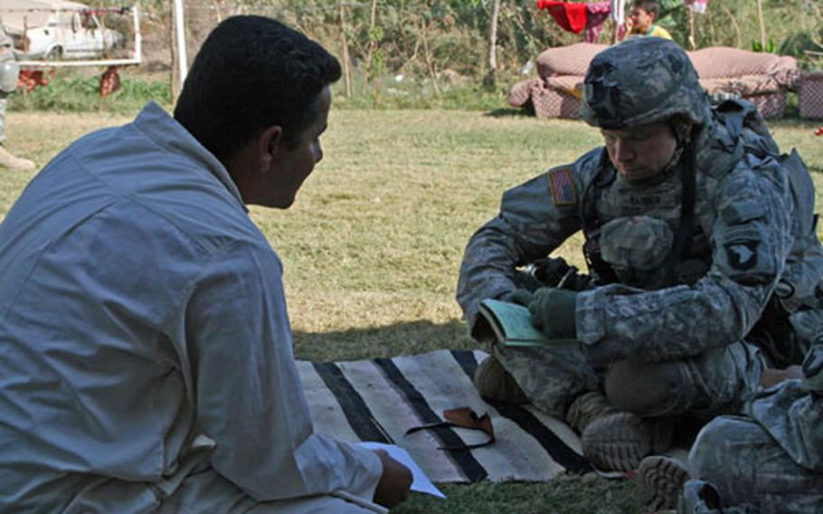 Second Lt. Red Barber, 23, of Macon, Ga., talks with an Iraqi man during a patrol near Beiji, Iraq. Barber, of 4th Platoon, Co. A, 1st Battalion, 327th Infantry Regiment said he wants to persuade Iraqis in his area to seek their own solutions to local problems, instead of relying on U.S. forces to solve those problems for them.