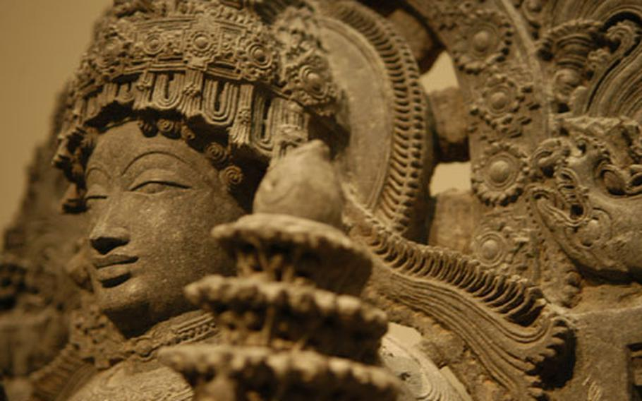 An intricate, limestone portrayal of Surya, the Hindu sun god, is on display at the Victoria and Albert Museum in London.
