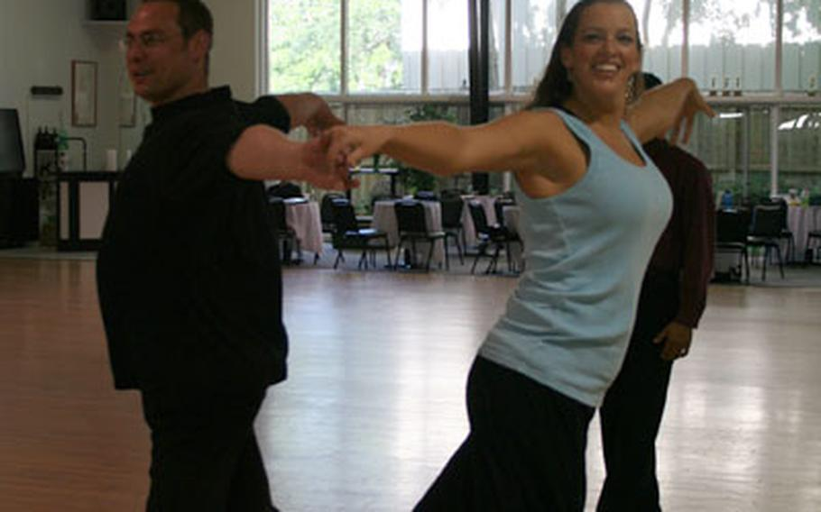 Staff Sgt. Leatz dances with famed ballroom dancing instructor Eddie Apolonov.