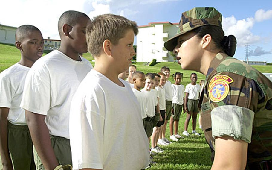 Lance Cpl. Rita Navarro, a senior drill instructor for Camp Foster's Young Marine boot camp, shouts out commands to Austin Payne, 12, a seventh-grader at Lester Middle School, on the first Saturday of the boot camp Sept. 8.