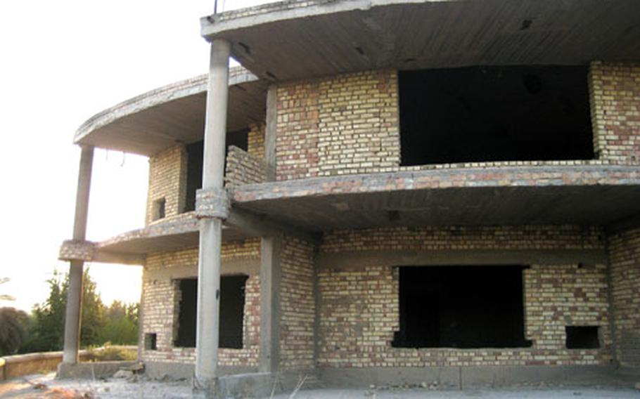An abandoned house along the Tigris River stands during the final hours of its existence Sunday. Shortly after midnight, a B-1 bomber dropped a 2,000-pound bomb on it, demolishing what soldiers from the 3rd Infantry Division's 1st Battalion, 15th Infantry Regiment said was used for insurgent attacks and surveillance.