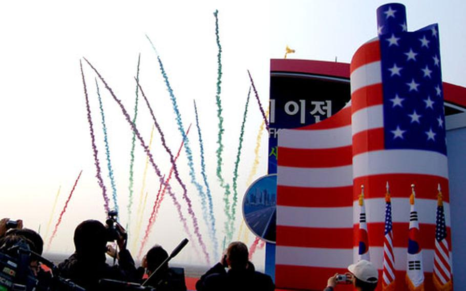 Colored smoke streaks into the sky at a ceremony Tuesday marking the groundbreaking at land that will support the U.S. Forces Korea expansion of Camp Humphreys.