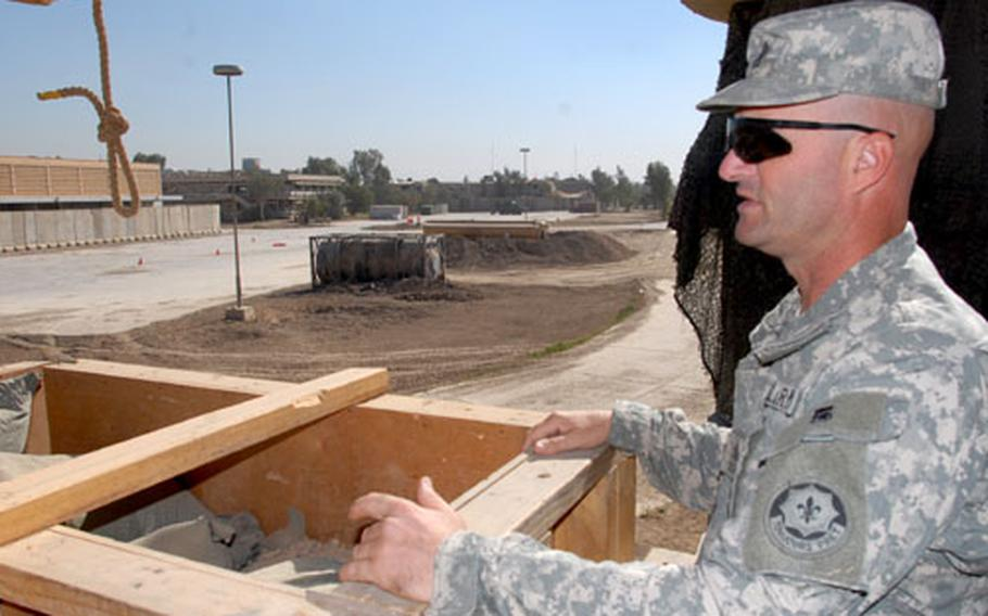 Company D, 2nd Squadron, 2nd Cavalry (Stryker) Regiment 1st Sgt. Michael White surveys Combat Outpost Aztec on Tuesday.