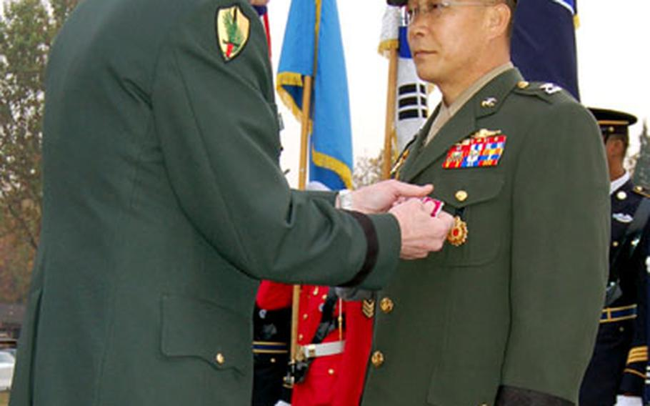 Combined Forces Commander Gen. B.B. Bell presents a Legion of Merit Medal to South Korean Marine Brig. Gen. Lee Ho-yeon during the CFC's 29th anniversary ceremony.