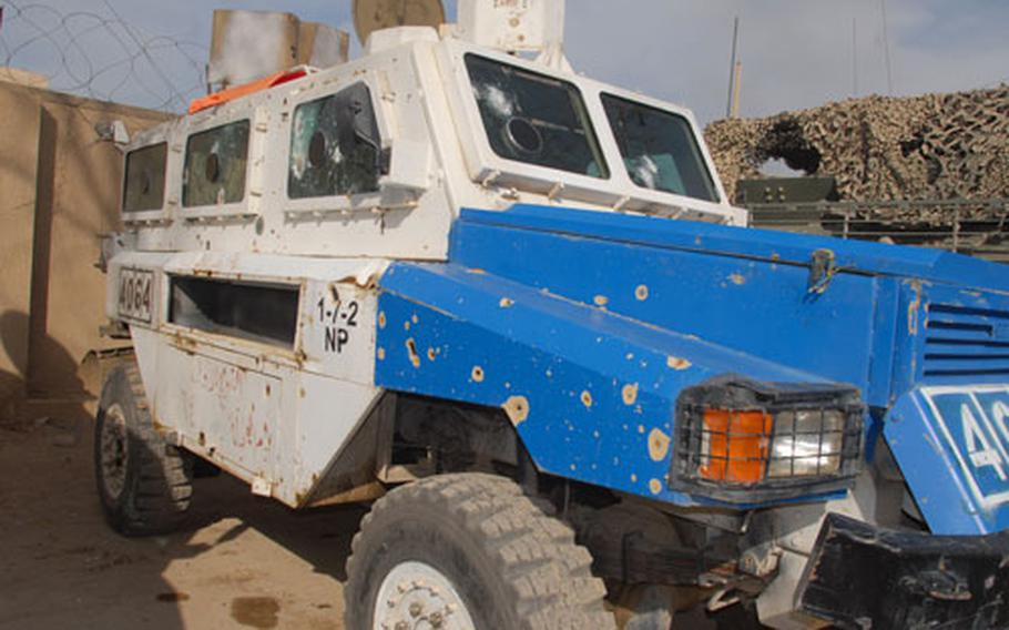 An Iraqi police vehicle shows the scars of war at Joint Security Station Cougar.