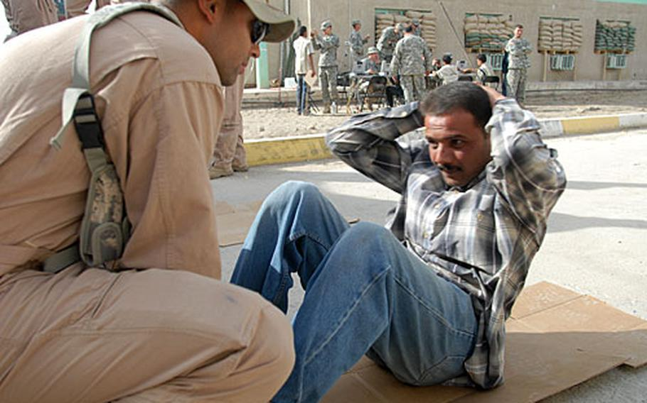 A Sunni applicant for an Iraqi security forces job does a physical training test at Joint Security Station Cougar.
