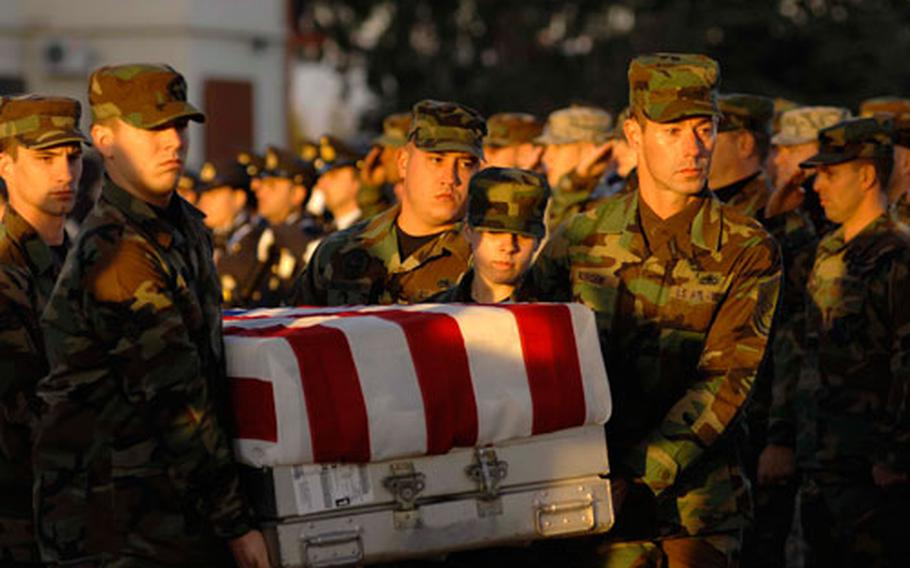 Airman from the31st Fighter Wing carry a fallen airman onto a C-130 during a repatriation ceremony at Aviano Air Base, Italy, in 2007. Six servicemembers were killed when a U.S. Army UH-60 Black Hawk helicopter attached to the 1st Battalion, 214th Aviation Regiment crashed Nov. 8, 22 miles southwest of Aviano, Italy.
