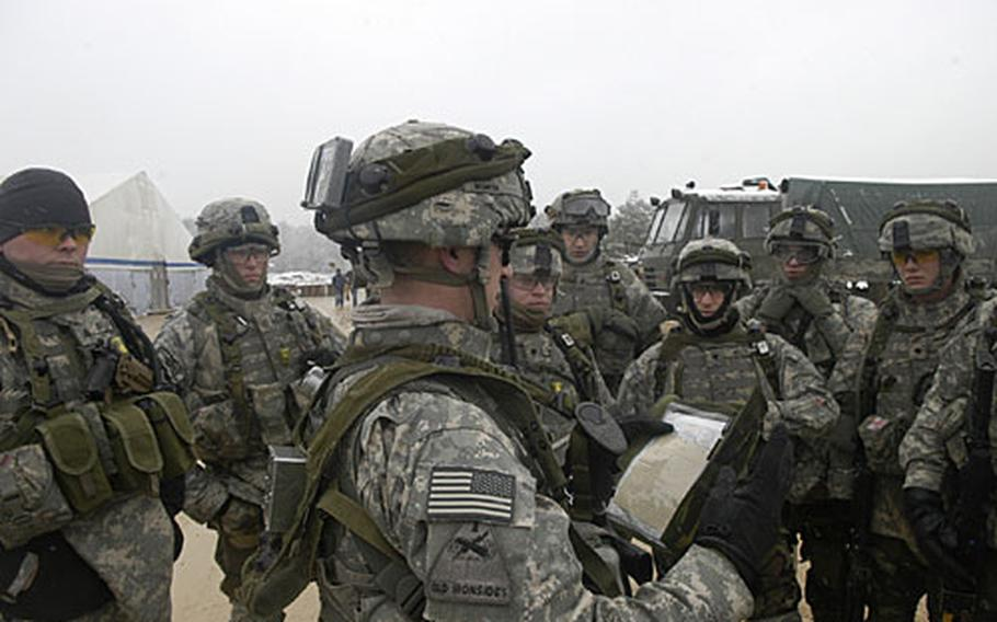 First Lt. James Worth delivers a convoy brief to Troop G soldiers before departing for a mission 25 kilometers from the Joint Multinational Readiness Center in Hohenfels, Germany. The unit, part of the Baumholder-based 2nd Brigade, 1st Armored Division, is busy training for its upcoming deployment to Iraq.
