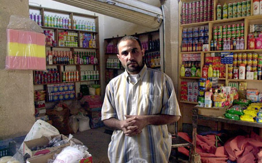 """Aziz Waresh, a shopkeeper at a market next to the new Combat Outpost Salie in Narwan, says he hopes the U.S. presence will eventually lead to better basic services for his city. """"I myself am happy with having the U.S. Army here,"""" he said, """"but I can't speak for everyone."""""""