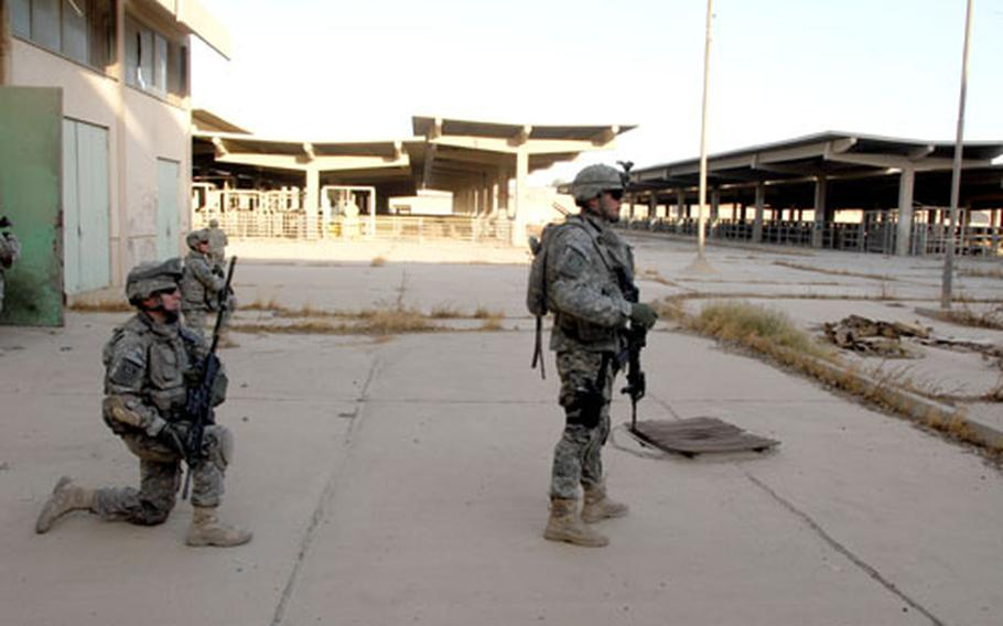 Company D, 2nd Squadron, 2nd Cavalry (Stryker) Regiment soldiers patrol through the grounds of what used to be Iraq's largest meat-works on Wednesday.